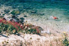 Person Swimming on the Beach Photography Royalty Free Stock Photography