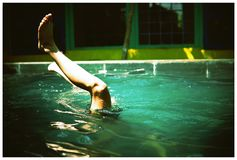 Person Swimming on Pool With Feet in the Air royalty free stock photos