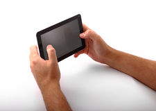 Person with tablet computer. Hands of person with tablet computer with blank screen, white studio background Royalty Free Stock Image