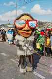 Person takes part in the parade at Lucerne carnival in Lucerne, Switzerland. Stock Image