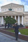 A person takes photos of Bolshoy theater building in Moscow. Stock Photos