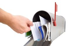 Person taking letter from mailbox Royalty Free Stock Photography