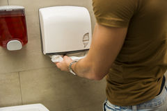 Person taking paper towels Stock Photo