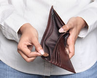 Person taking a penny from wallet - Bankruptcy. Business person taking a penny from a wallet Stock Photos