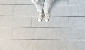 Person taking photo of his feet stand on concrete floor Royalty Free Stock Photography