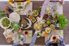 Person taking picture of food Stock Image