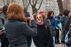 Person taking a picture of girl in makeup in international action for the protection of animals `Fair Play` in Volgograd. Volgograd, Russia - March 31, 2012 Stock Photo