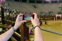 Person taking video of corrida Stock Images
