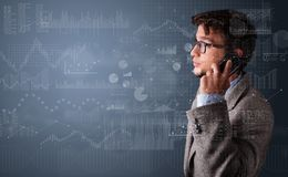 Person talking on the phone with chart and report in the foreground royalty free stock image