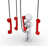 Person talking on phone receiver and others hanging from above Royalty Free Stock Image