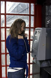 Person talking public phone Royalty Free Stock Images