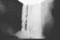 Person by tall waterfall Royalty Free Stock Photo