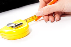 Person with tape measure Stock Images
