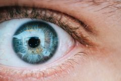 Person With Teal and Yellow Left Eye Stock Photo