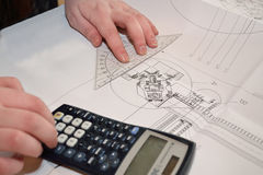 Person with technical drawing Royalty Free Stock Images