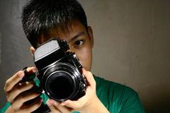 Person or Teen Looking Through a Medium Format Film Camera Stock Image