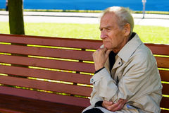 Person Thinking. Portrait of the old pensive man thinking Stock Images