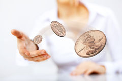 Coin as symbol of risk and luck. Person throwing a coin as symbol of risk and luck stock photography