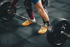 Person About to Start Lifting the Barbell Inside the Gym Royalty Free Stock Photography