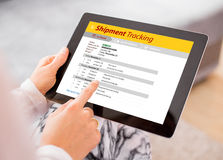 Person tracking shipment on tablet. Computer Stock Photos