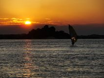Person training windsurf in the holidays with the sunset in the background. In a resort royalty free stock image
