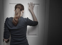 Person trapped behind a door. Stock Images