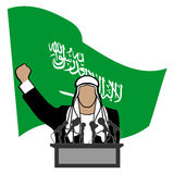 Person on a tribune against a flag of Saudi Arabia Stock Image