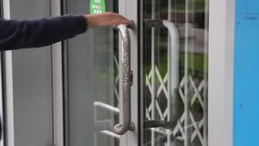 A person tries to open the closed door stock video