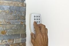 Person triggering an alarm Royalty Free Stock Images