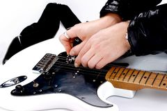 Person tuning a guitar Royalty Free Stock Photos