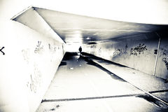 Person in Tunnel. Urban Grunge Shot with lots of Texture Stock Image
