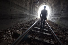 Person in a tunnel looking towards the light Royalty Free Stock Images