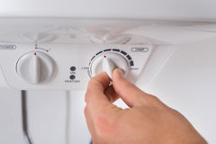 Person Turning The Knob Of Electric Boiler Royalty Free Stock Photo
