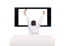 Person and tv-set. Teenager with hands up watching tv-set royalty free stock photography