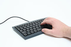 Person Typing On Keyboard. A hand is typing on a keyboard Royalty Free Stock Photo
