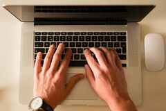 Person typing on laptop computer Stock Photos