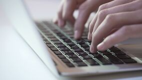 Person typing on laptop keyboard, freelancer sending project to client by email