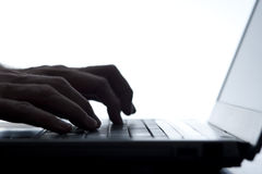 Person typing on a laptop keyboard Stock Photography