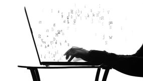 Person typing on a laptop stock footage