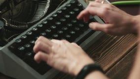 Person typing on manual typewriter stock video