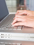 Person Typing on a modern laptop Royalty Free Stock Image