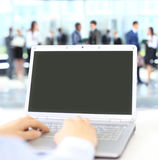 Person Typing on a modern laptop in an office Royalty Free Stock Images