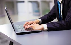 Person Typing on a modern laptop Stock Photo