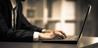 Person Typing on a modern laptop Royalty Free Stock Images