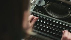 Person typing on old typewriter. Cropped shot of person typing on old-fashioned typewriter stock footage