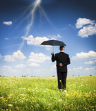The person with an umbrella. A businessman holding an umbrella in a storm Stock Photography