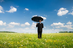 The person with an umbrella. In the field stock image