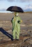 Person with umbrella waits radioactive rain Royalty Free Stock Photo