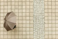 Person with umbrella. Weather nature atmosphere protection relax concept. Person with umbrella. Someone walking in rain covering himself from water Stock Photos