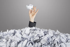 Person under pile of documents Royalty Free Stock Image